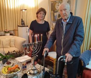 holocaust survivres lightning Hanukkah candles